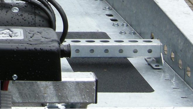 Wheel chocks, pair of individually adjustable position in front of bed area