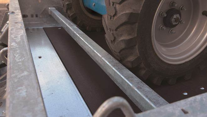 Machine stop bar, adjustable position. Allows a machine to be carefully positioned